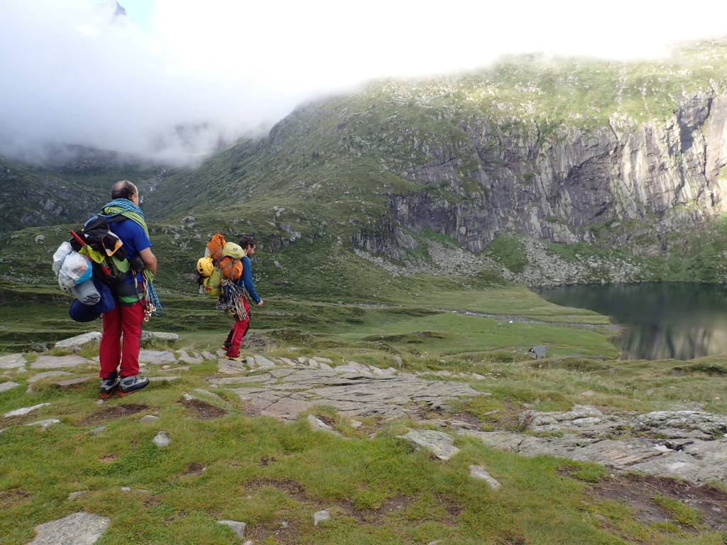 Two climbers heading to the rock wall above Lac d'Espingo.