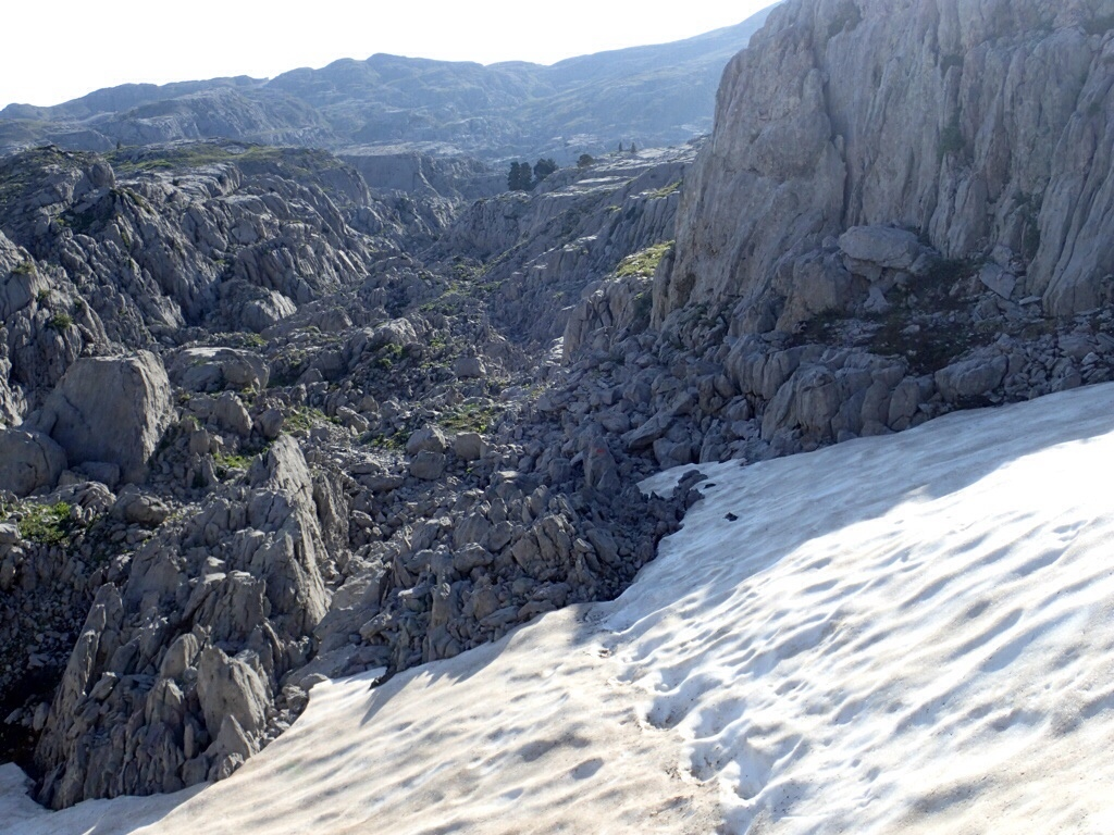Trail in a rocky canyon with snow.